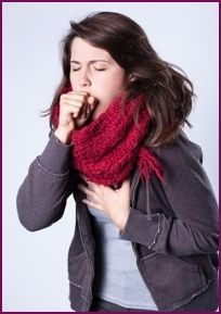 Woman Coughing Wearning a Large Red Scarf